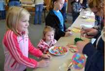 Children making arts and crafts in the library.