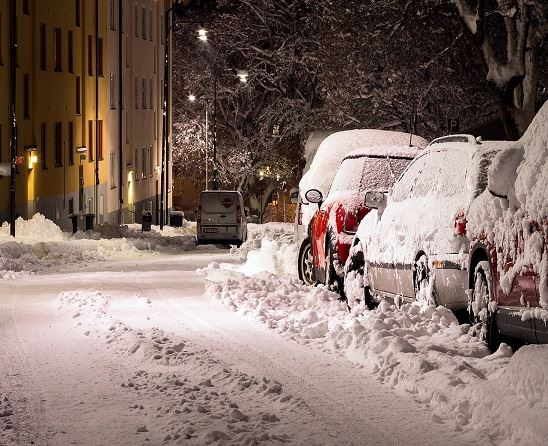 snow-covered-street-and-cars