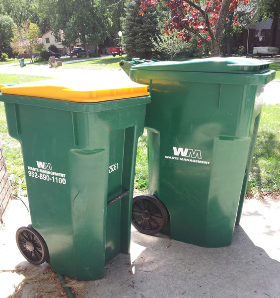 2 trash and recycling green bins for Waste Management